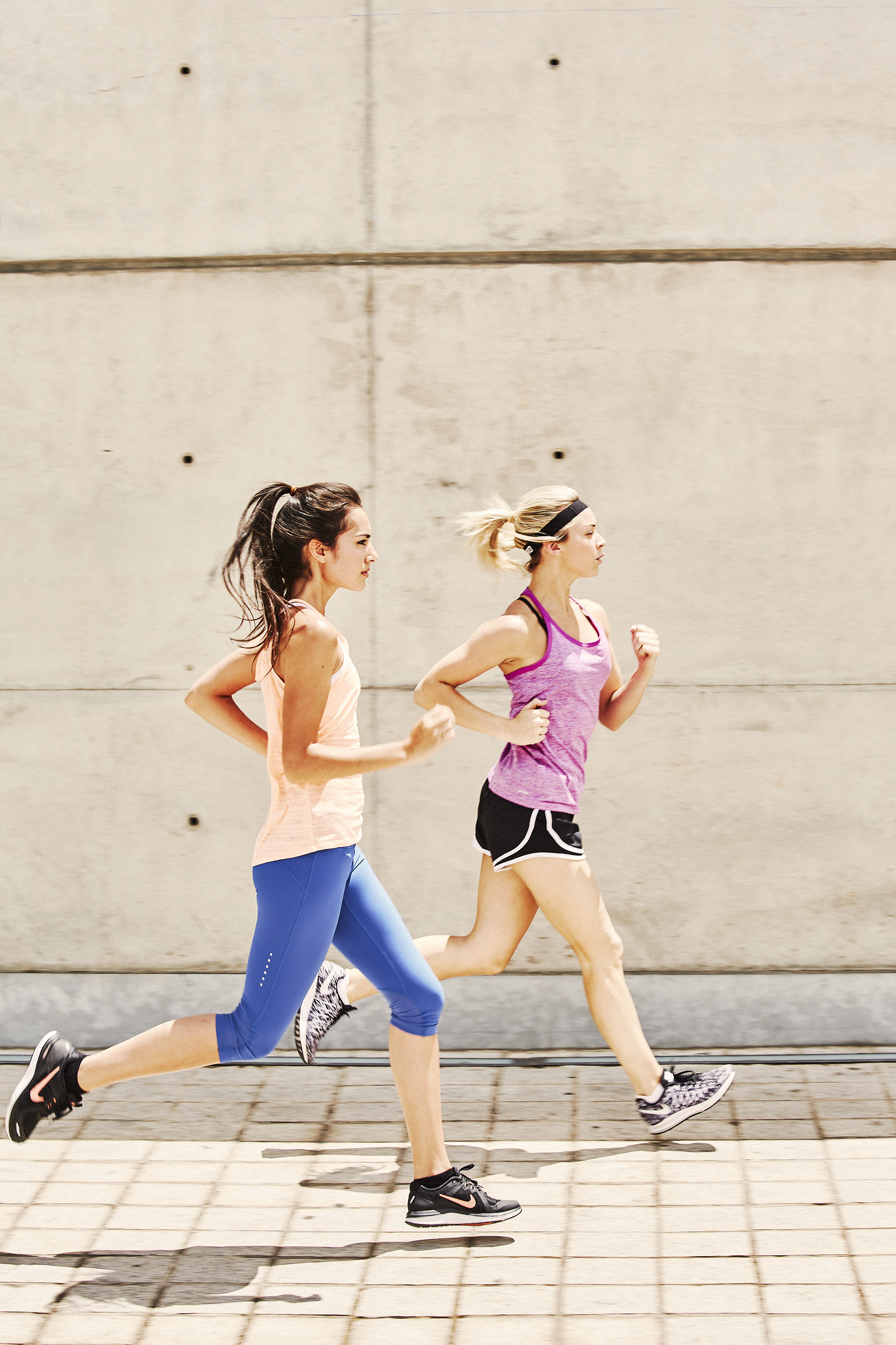 two girls running in Barcelona