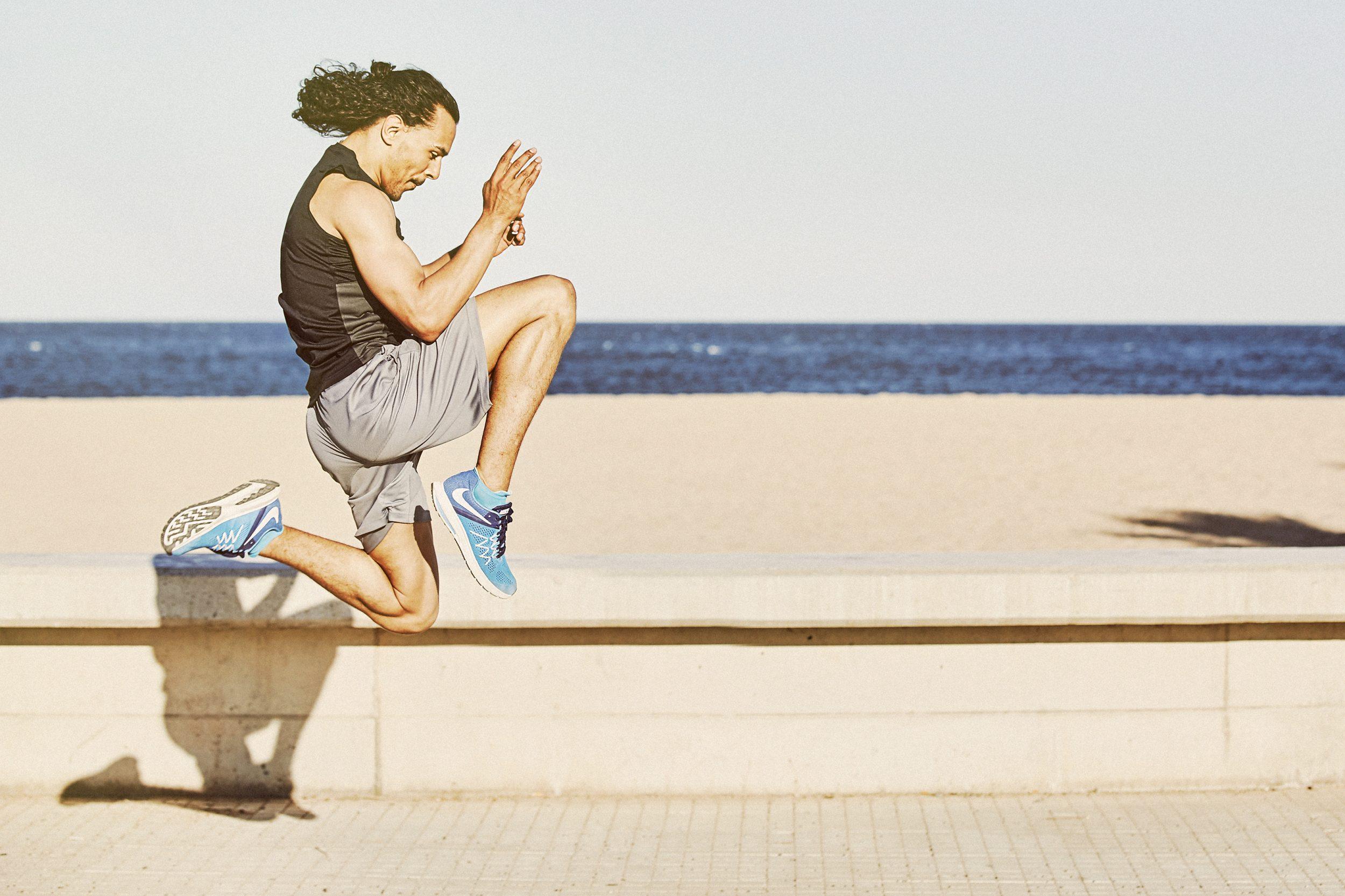 athlete running along the beach on Barcelona