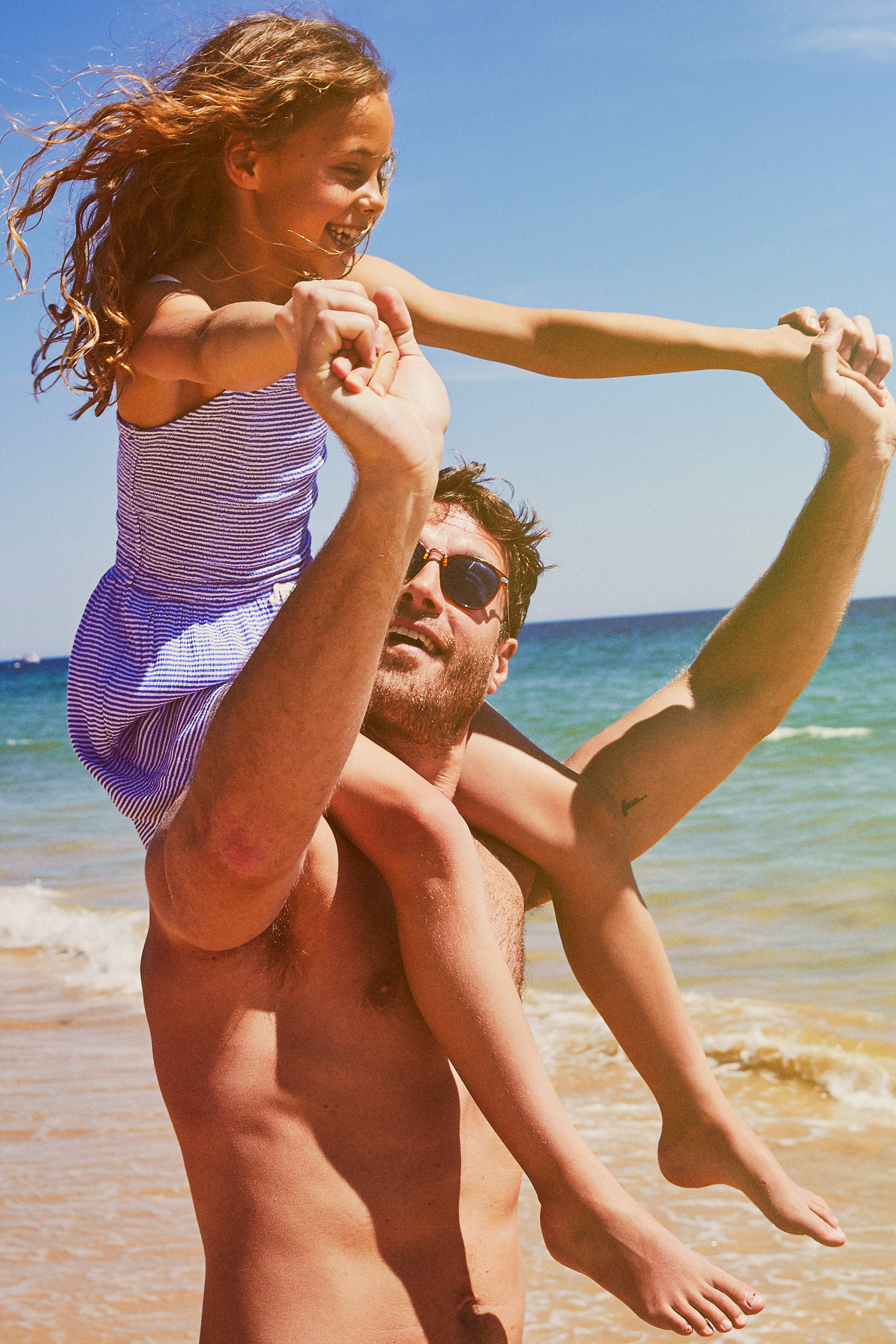 Dad and girl on beach