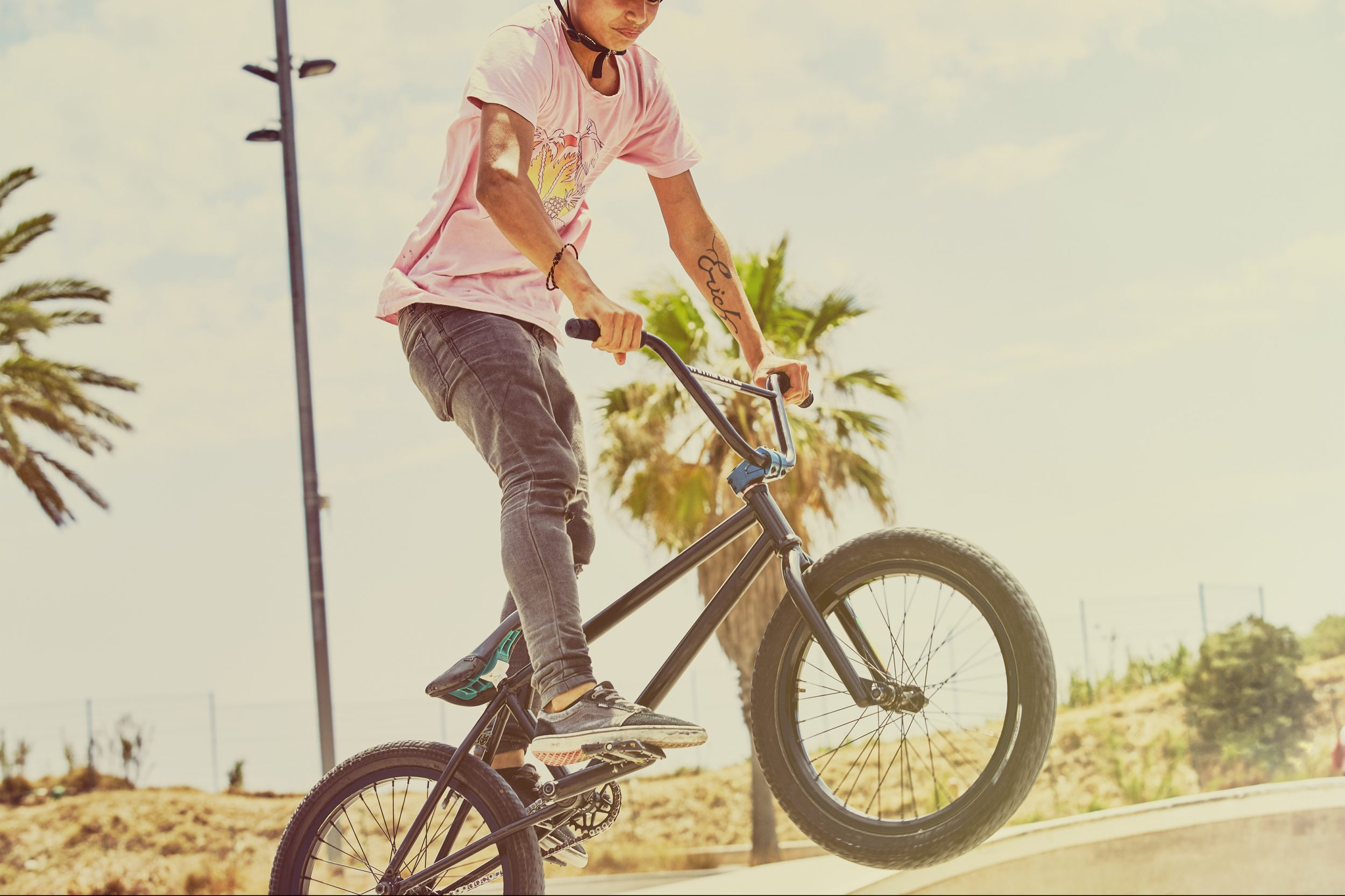 BMX rider catching some air at Barcelona skatepark