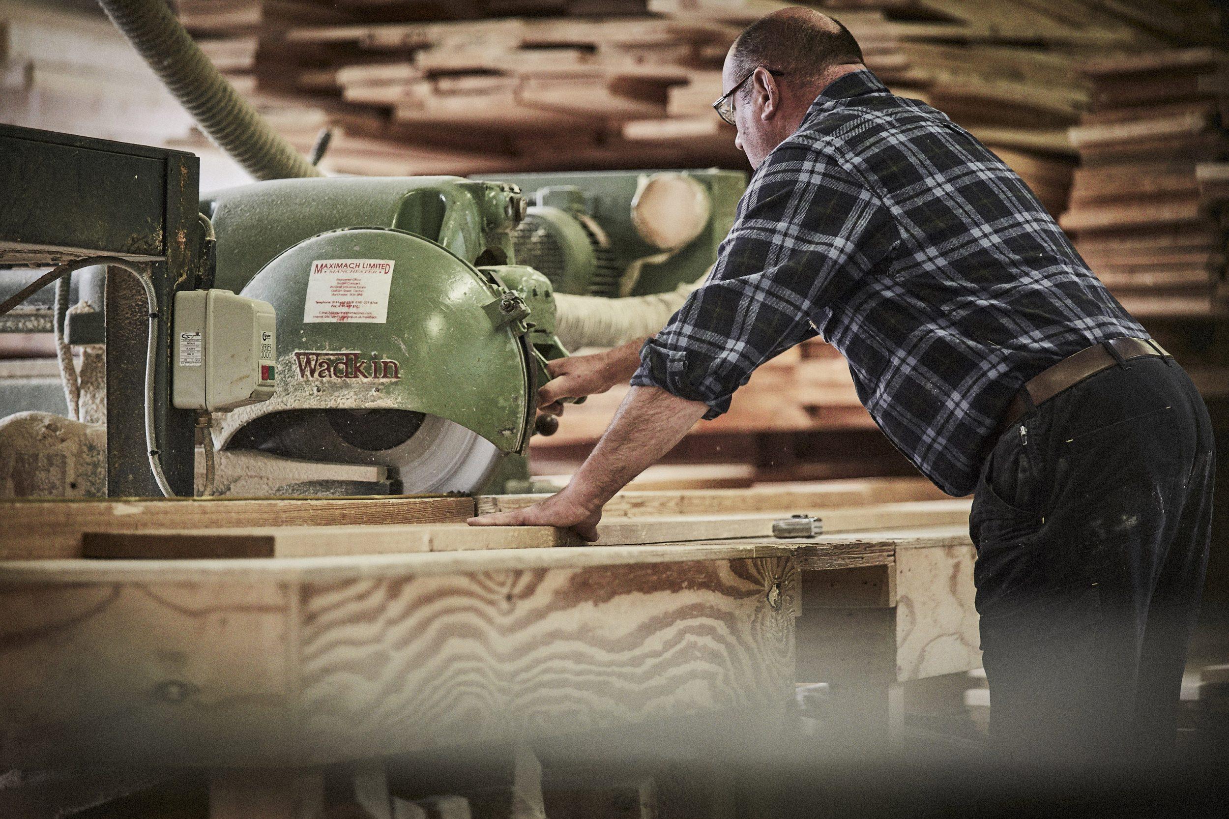 artisan cutting timber