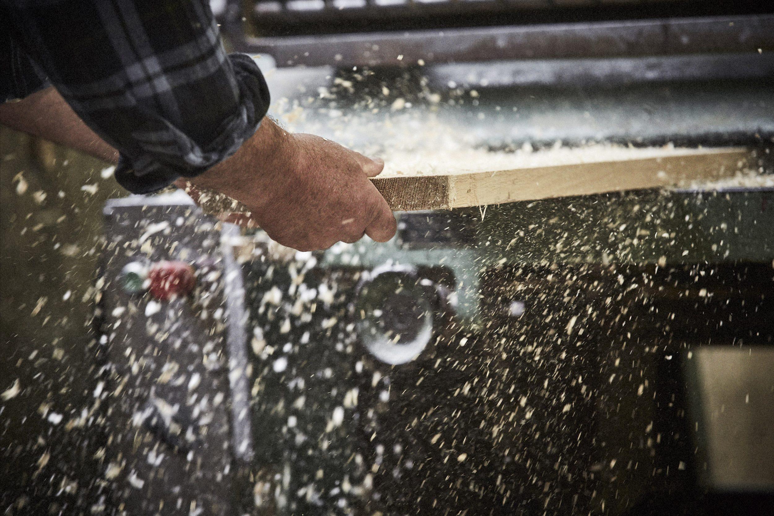 artisan planing a length of timber