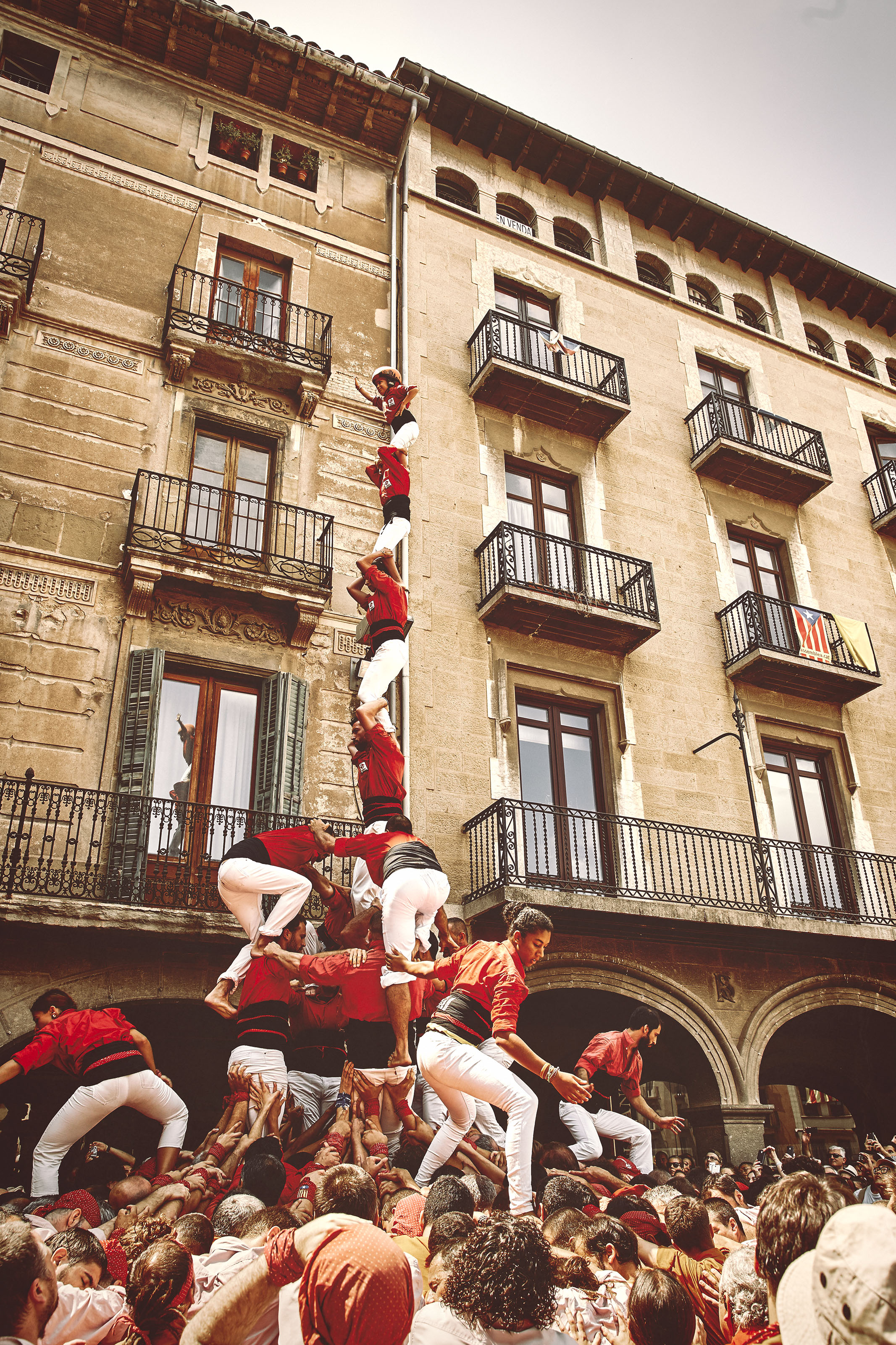 Castellers dismantling a human tower