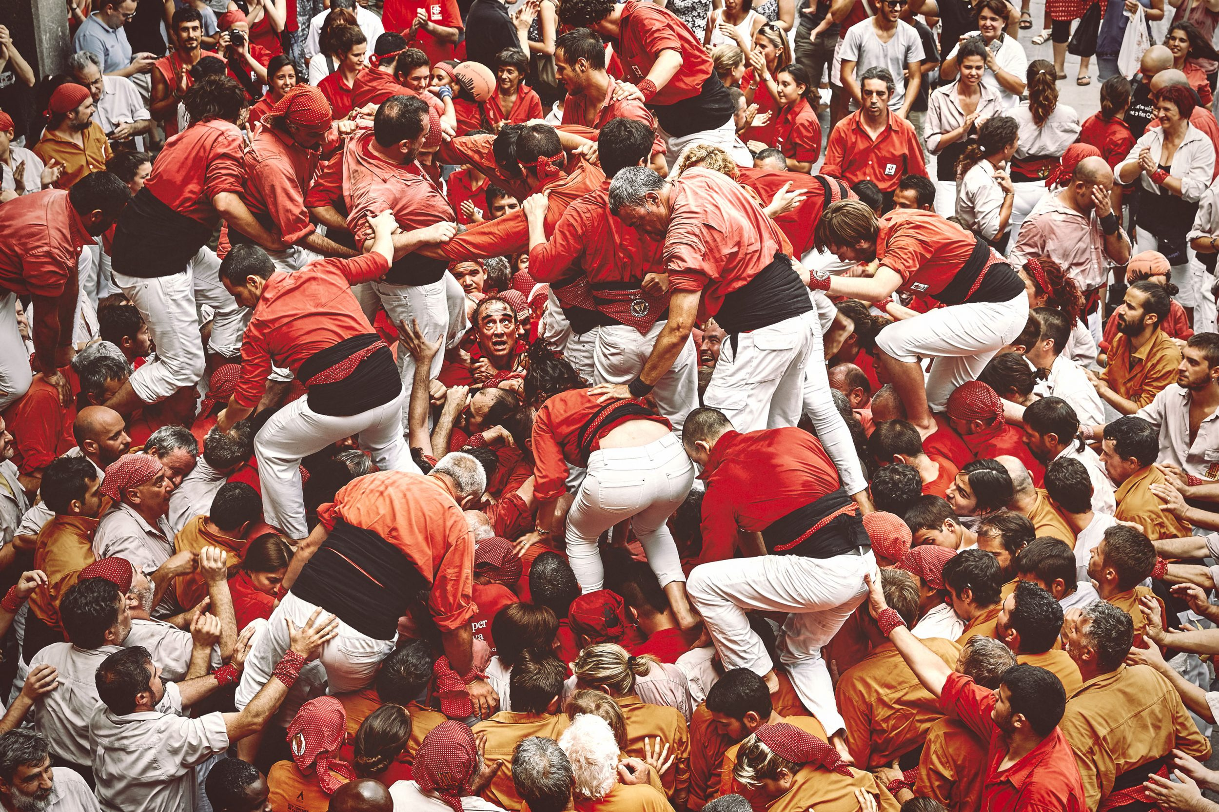 Castellers beginning to build a Castell