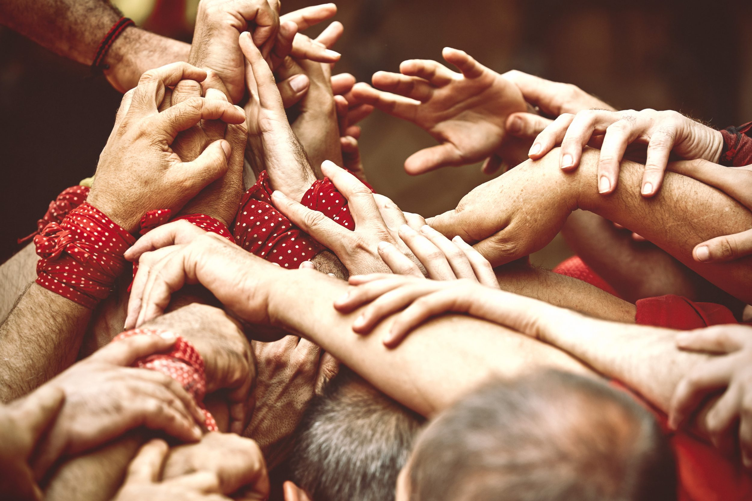 Castellers working as a team to build a human tower