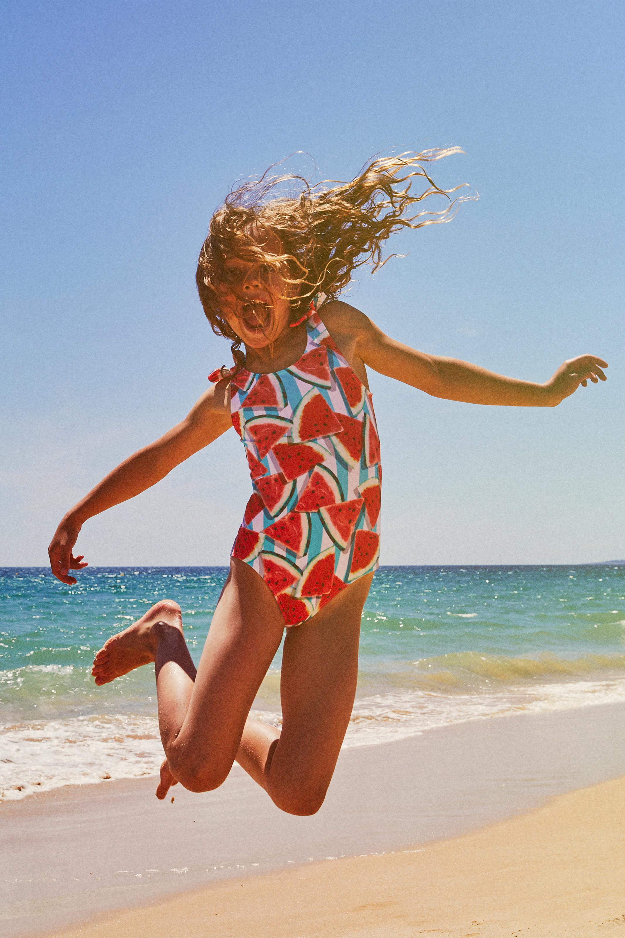 Girl playing on beach