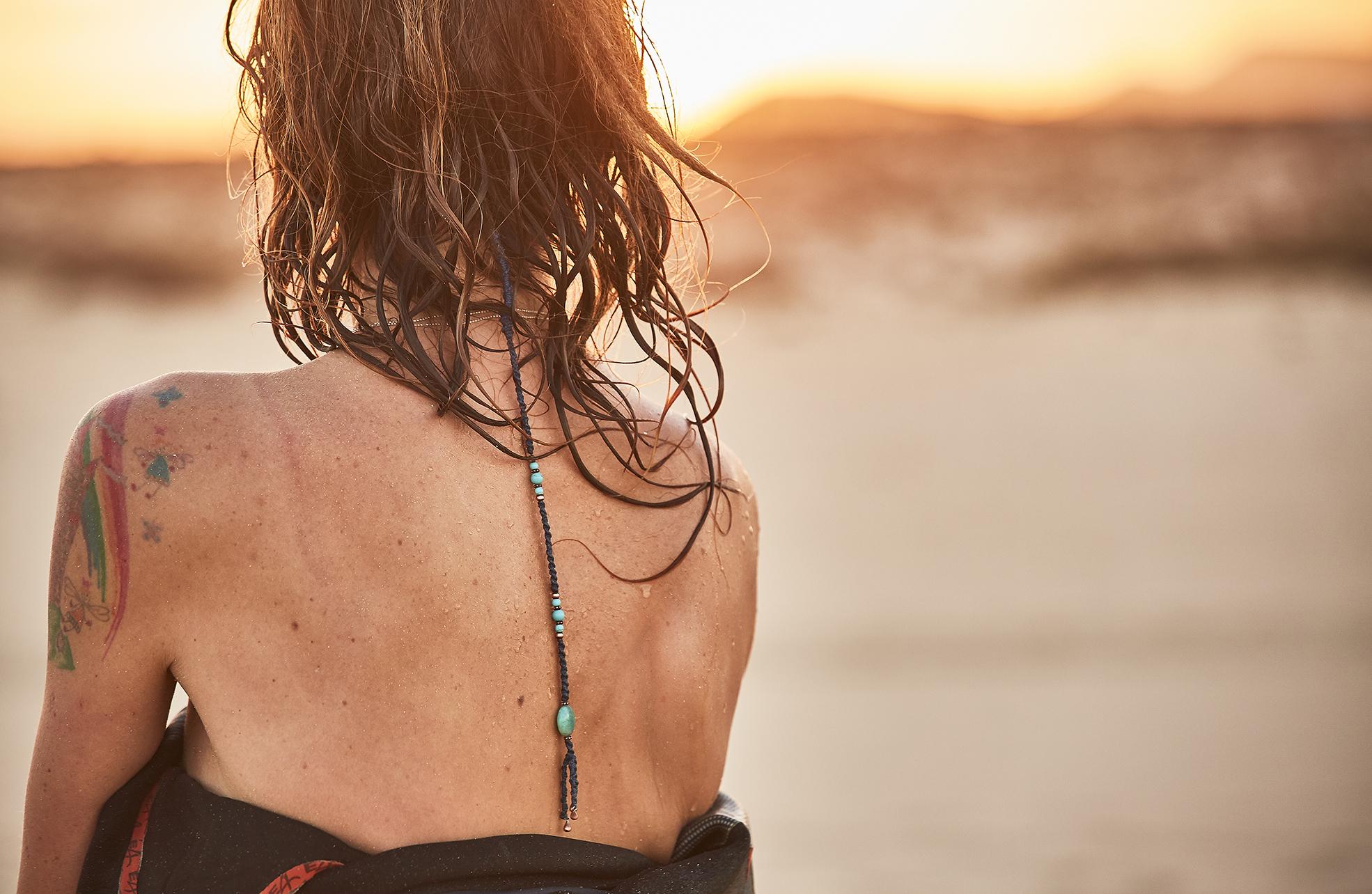 female surfer at sunset