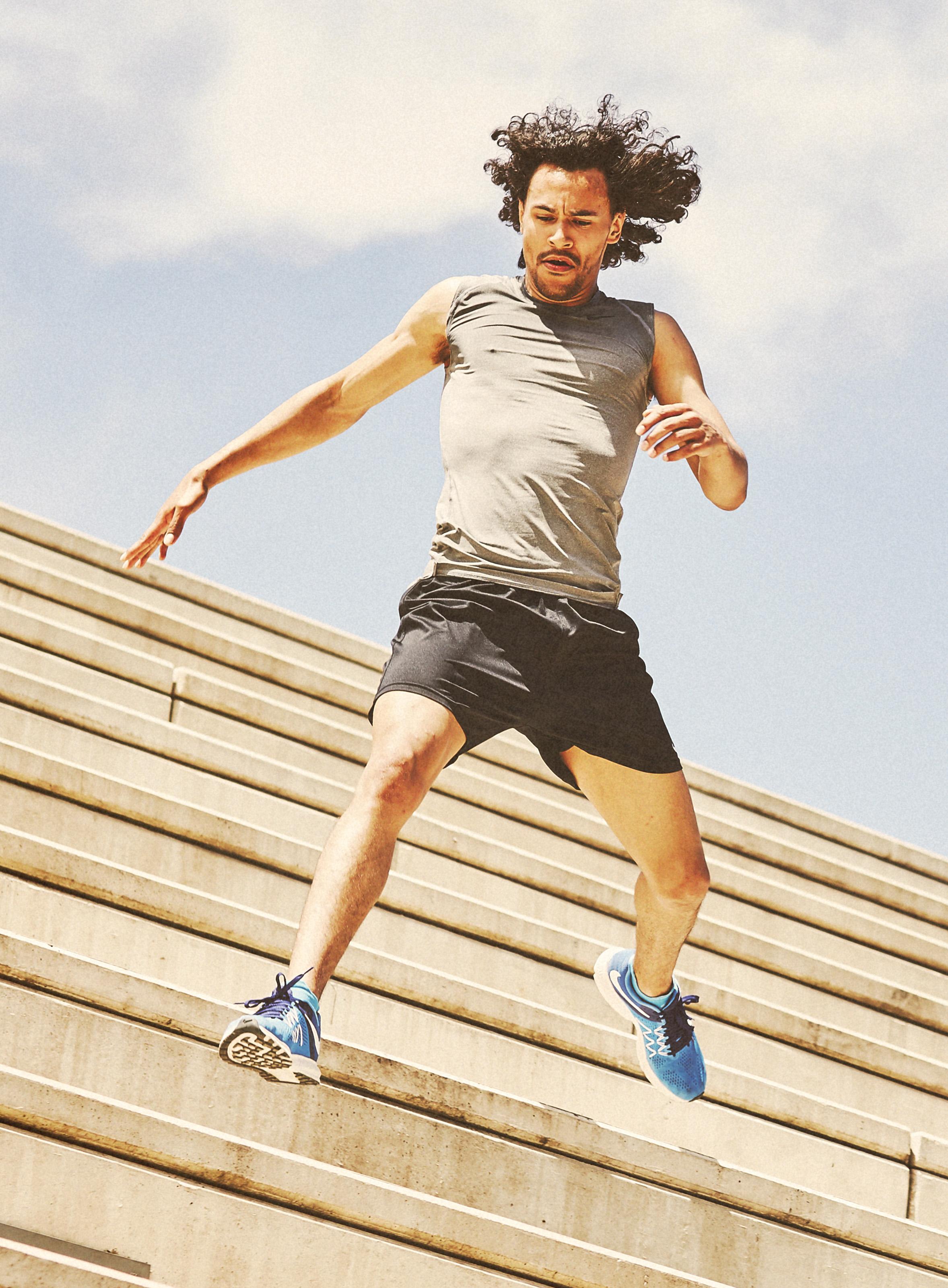 athlete caught mid flight running down stairs