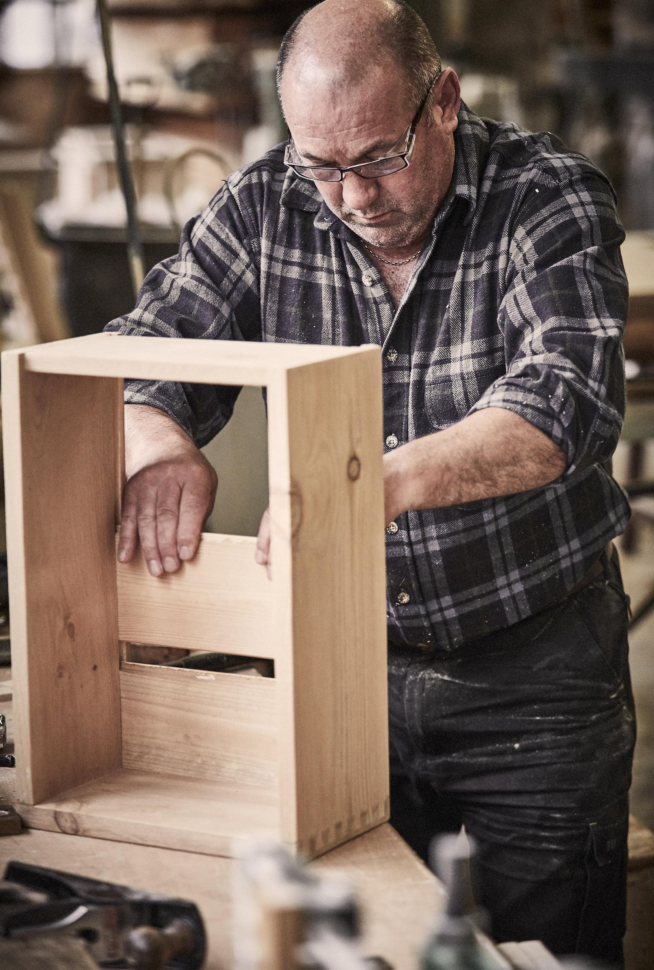 craftsmen hand making drawers