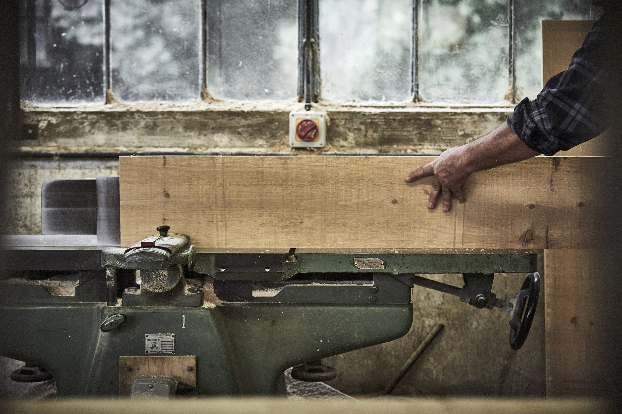 craftsmen working on a piece of timber